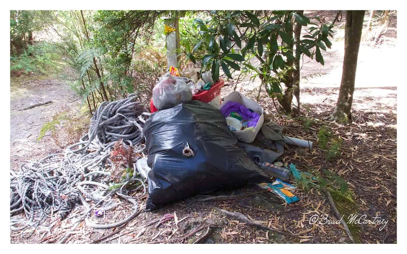 Rubbish left at Osmiridium Beach Campsite