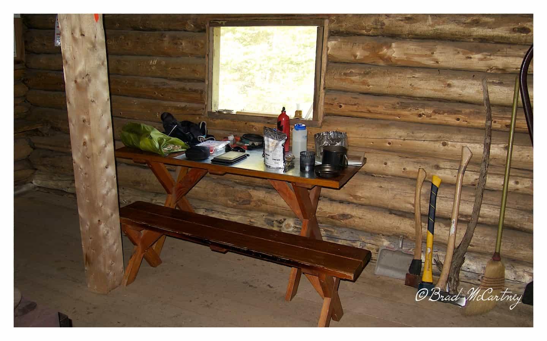 Cooking dinner inside Upper Lindeman cabin