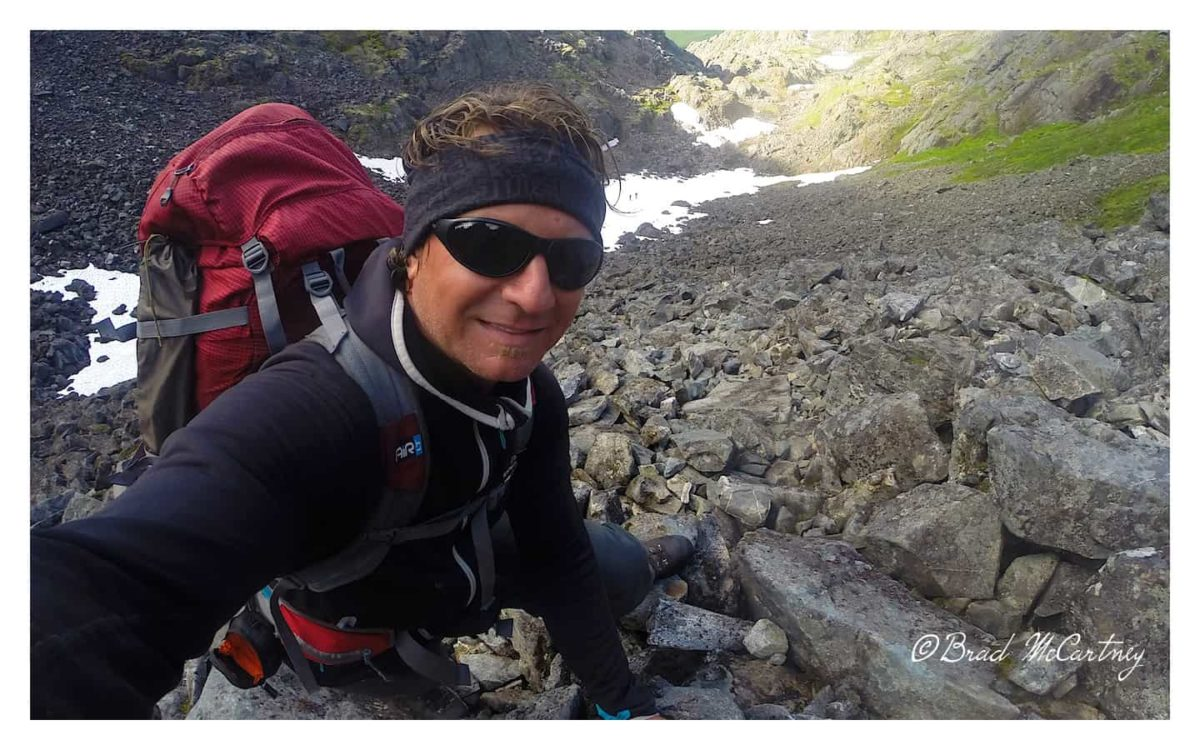 Climbing the 45 degree angle slope of the Golden Staircase on route to the Chilkoot Pass