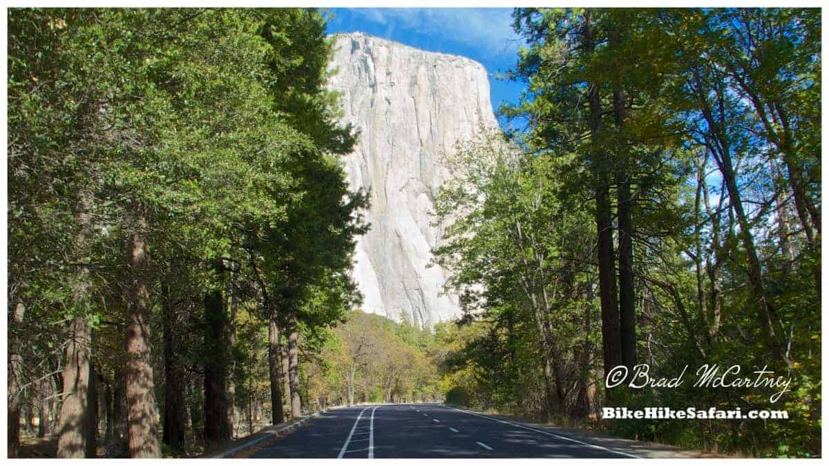 bicycle touring past El Capitan from the road through the valley