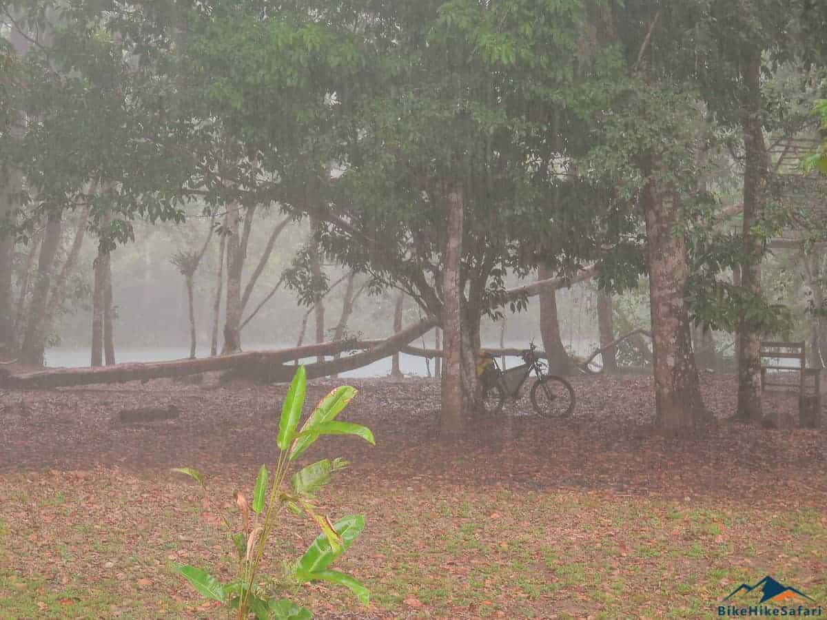 Tropical rainstorm at the campsite next to the river Lakanjá