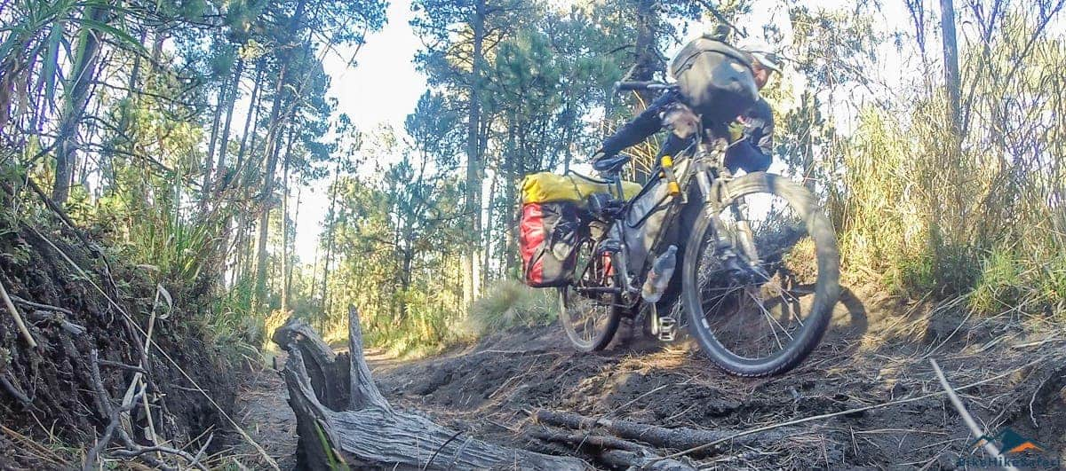 Climbing Lan Malinche with a bicycle