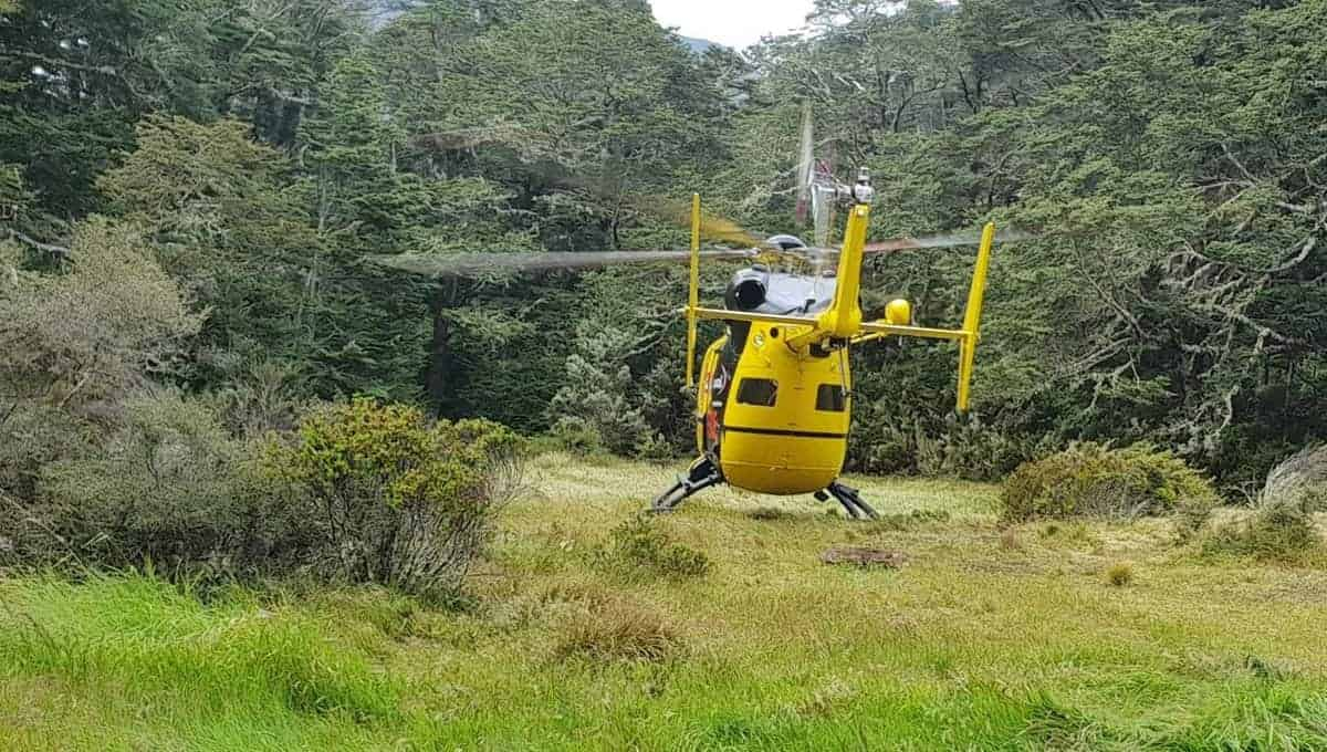 rescue helicopter in new zealand picking up an injured hiker