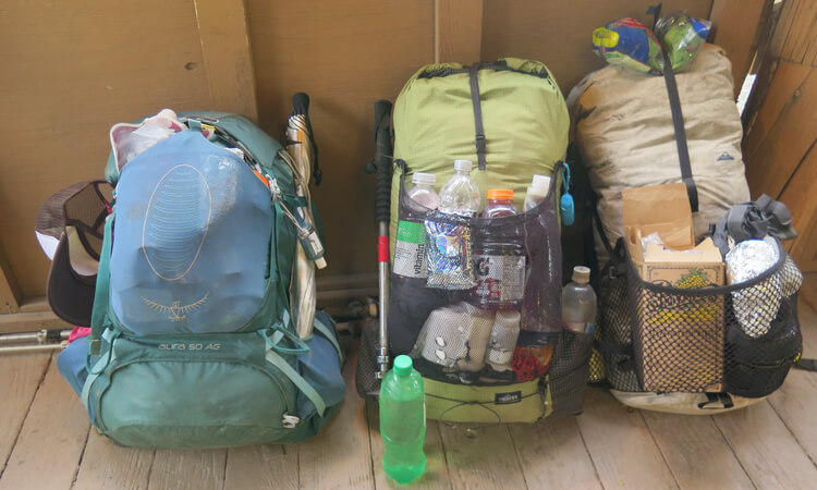 3 well used backpacks on the CDT