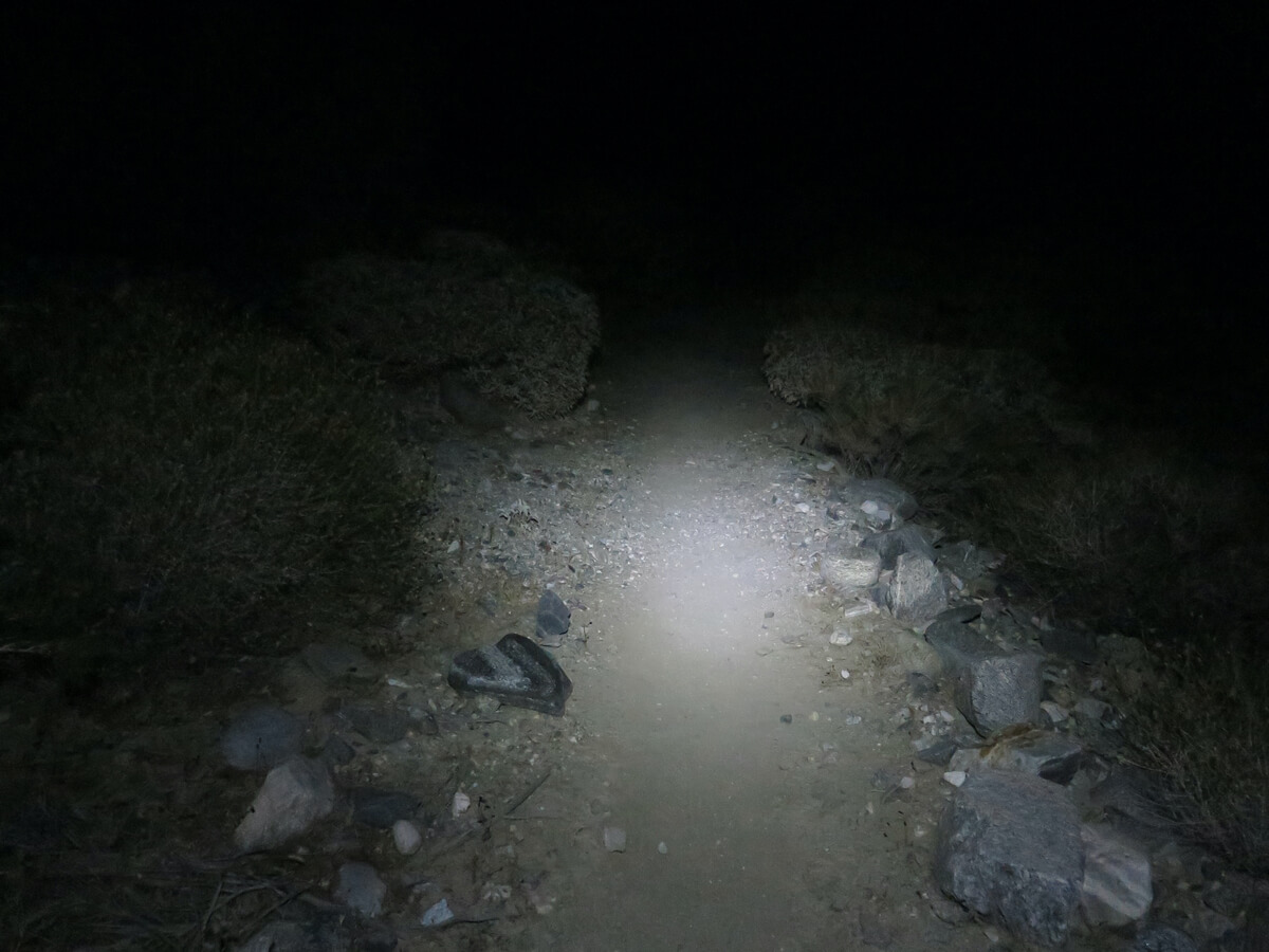 Best Headlamps for Backpacking. Hiking through the Desert at nighttime using a bright hiking headlamp