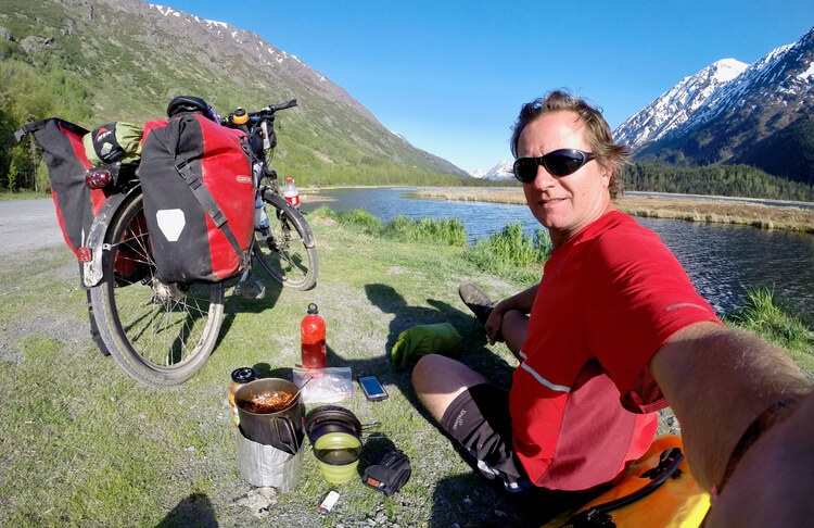 Using an alcohol stove for a quick roadside meal while Bicycle Touring in Alaska