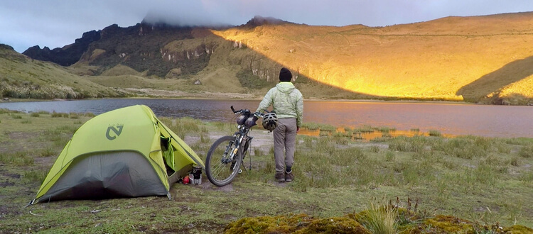 Using a tent that is adaptable for hiking and bicycle touring